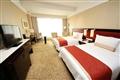 豪華客房整潔、寬敞、舒適,能讓房客享有安穩的睡眠。